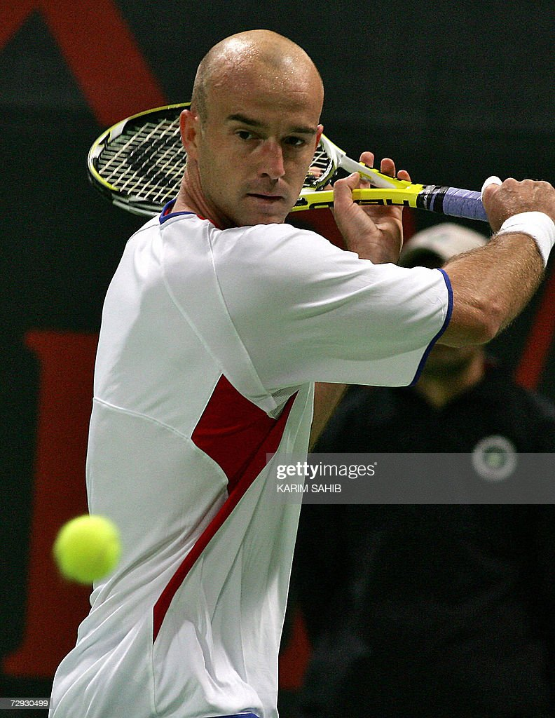 Ivan Ljubicic of Croatia returns the ball to Sweden's Robin Soderling during their semifinal match at the onemilliondollar Qatar Open ATP tennis...
