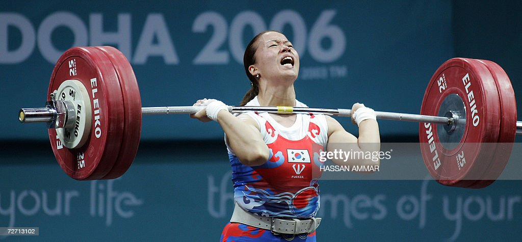 Kim Mi Kyung of South Korea lifts to win the bronze medal in the 69kg category in women's weightlifting at the 15th Asian Games in Doha 04 December...
