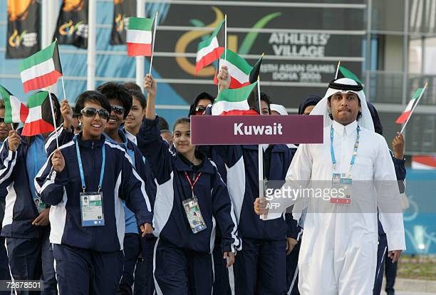 Kuwaiti athletes attend their welcoming ceremony in the athletes village at the 15th Asian Games in Doha 30 November 2006 one day before the games...