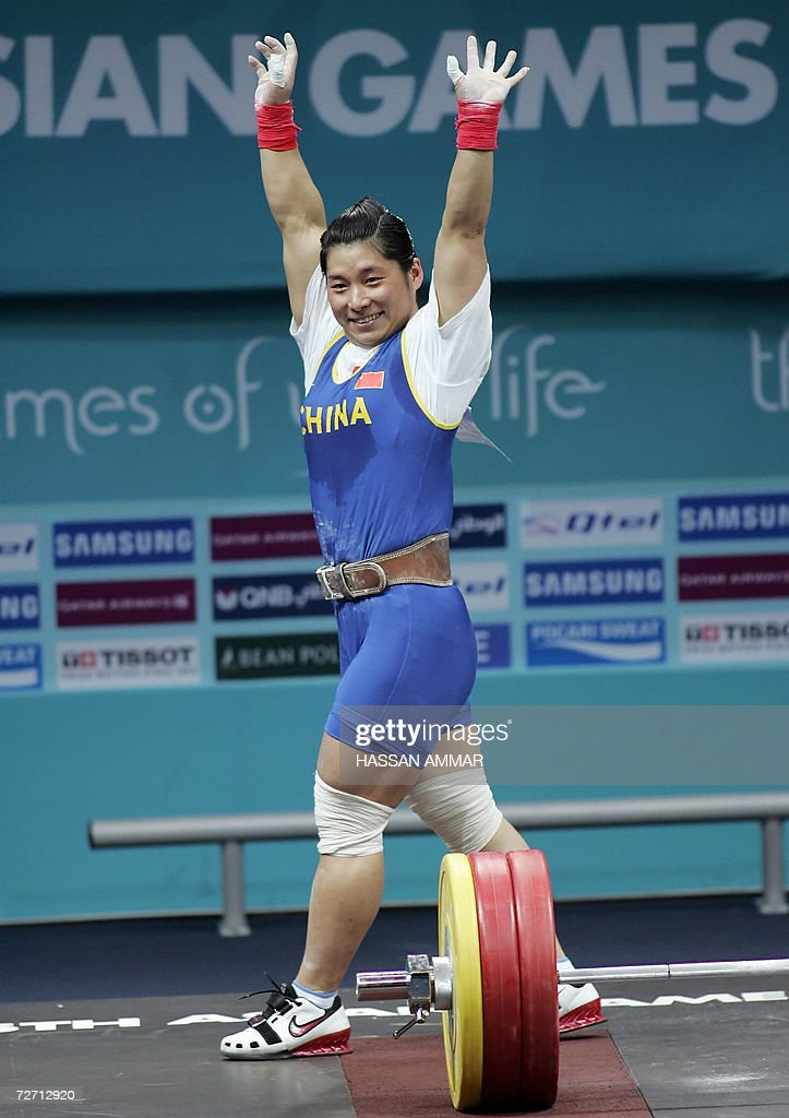 Liu Haixia of China waves after she won gold in the 69kg category in women's weightlifting at the 15th Asian Games in Doha 04 December 2006The...