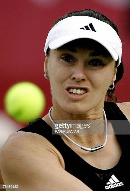 Martina Hingis of Switzerland eyes the ball during her WTA Qatar Total Open quarterfinal game against Daniela Hantuchova of Slovakia in Doha 01 March...