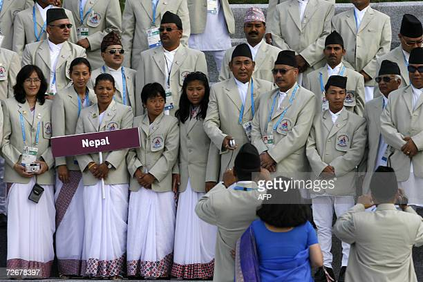 Nepalese athletes attend their welcoming ceremony in the athletes village at the 15th Asian Games in Doha 30 November 2006 one day before the games...
