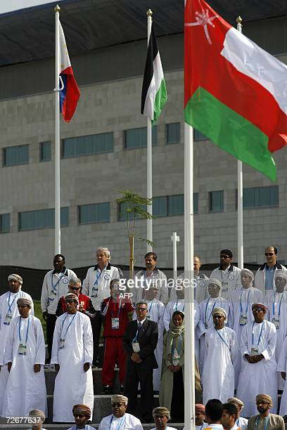Omani athletes listen to their national anthem at their welcoming ceremony in the athletes village at the 15th Asian Games in Doha 30 November 2006...