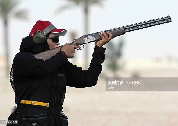 Qatari female shooter Saada Mahawesh participates in a skeet training session 30 November 2006 one day before the 15th Asian Games officially open...