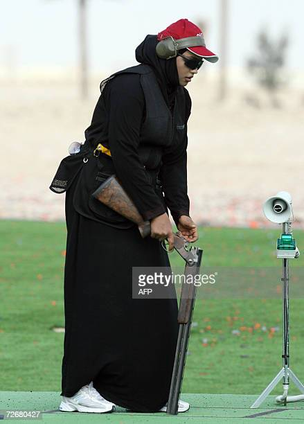 Qatari female shooter Saada Mahawesh prepares for a skeet training session 30 November 2006 one day before the 15th Asian Games officially open More...