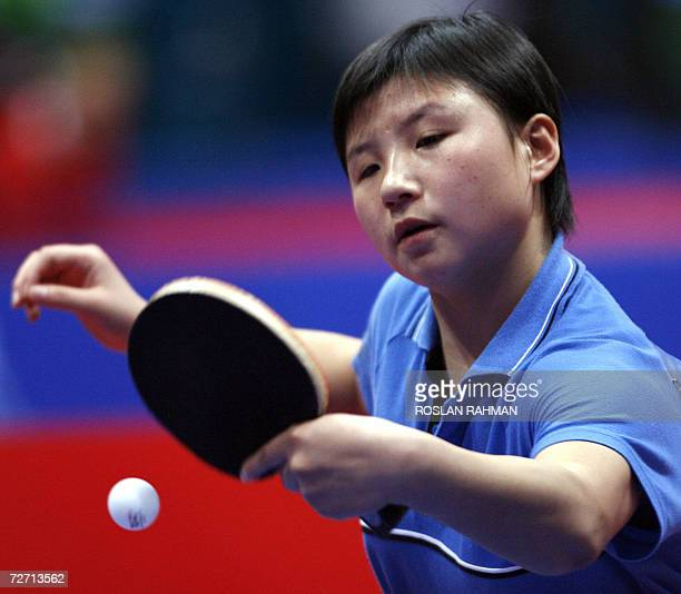 South Korea's Kim Jong competes against Vietnam's Luong Thi Tham during the Women's Single of the round 32 match at the AlArabi Sports Club during...