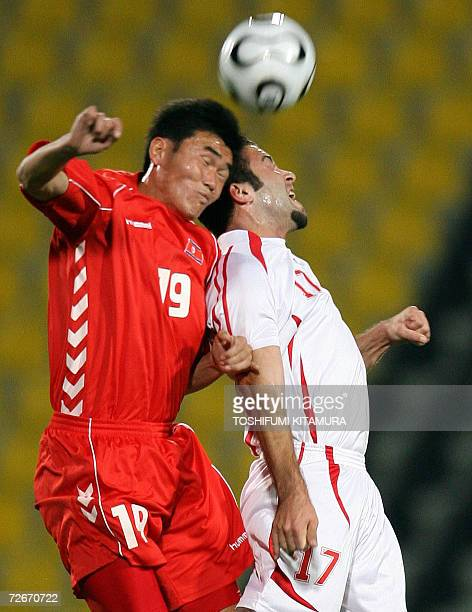 Syrian Abd Alkader Dakka fights for the ball with North Korean forward Jong SuHyok during their Asian Games Round 2 Group F fottball match at the...