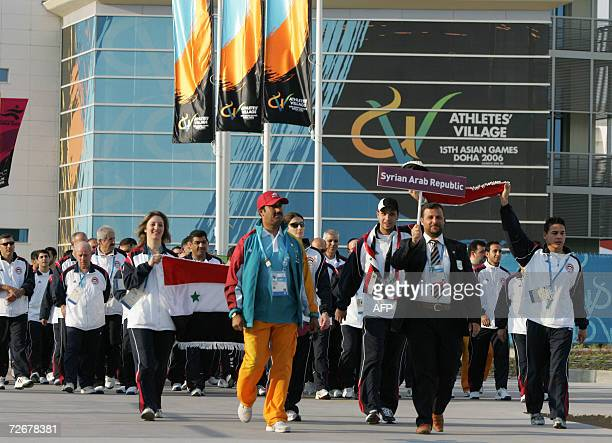 Syrian athletes arrive at their welcoming ceremony in the athletes village at the 15th Asian Games in Doha 30 November 2006 one day before the games...