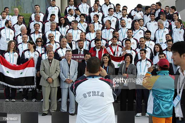Syrian athletes attend their welcoming ceremony in the athletes village at the 15th Asian Games in Doha 30 November 2006 one day before the games...