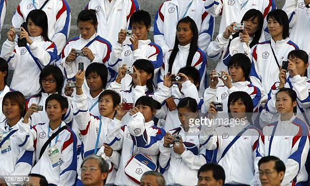 Taiwanese athletes attend their welcoming ceremony in the athletes village at the 15th Asian Games in Doha 30 November 2006 one day before the games...