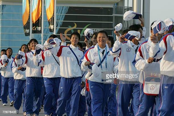 Taiwanese attend their welcoming ceremony in the athletes village at the 15th Asian Games in Doha 30 November 2006 one day before the games official...