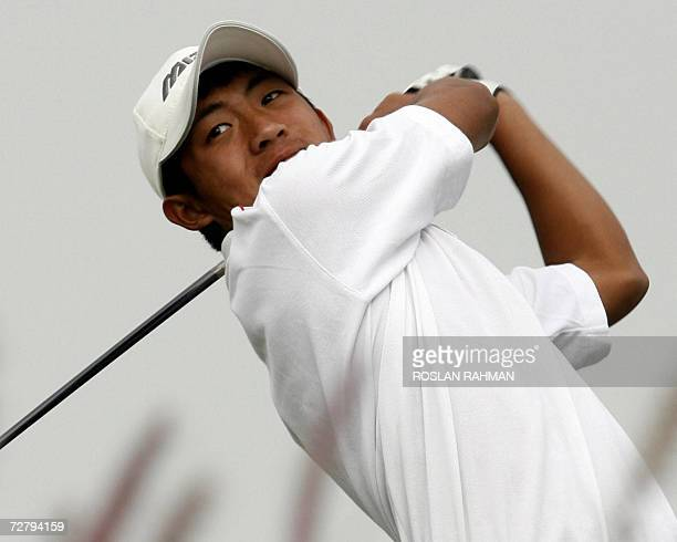 Taiwan's golfer Pan Cheng Tsung teesoff from the 9th tee in the Men's Golf Individual final round during the 15th Asian Games in Doha 11 December...