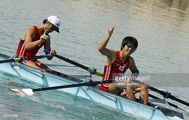Team Japan celebrates after winning the gold medal in the Men's Lightweight Double Sculls Rowing Competition at the West Bay Lagoon during the 15th...