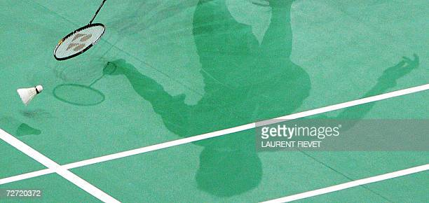 The shadow of Malaysian badminton player Lee Chong Wei is seen on the court as he tries to make a save from South Korean Lee Hyun Il in their men's...