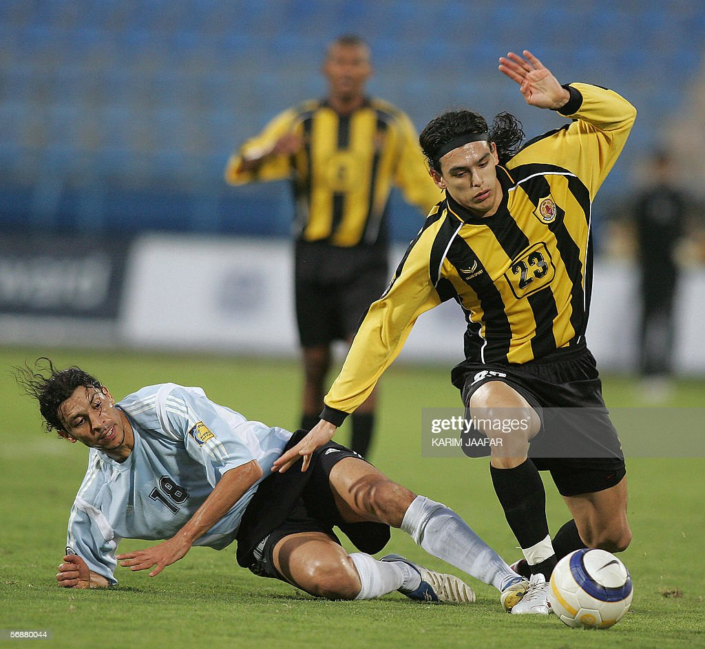 Uruguay player Sebastian Soria of Qatar club vies with Moroccan player Yousef Chippo of alWakra club during their Qatar championship match in Doha 18...