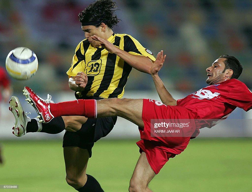 Uruguay's player Sebastian Soria of Qatar club vies with alArabi player Salman Issa of Bahrain during their Qatar championship match in Doha 31 March...