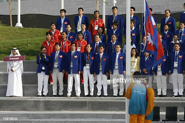 Vietnam athletes attend their welcoming ceremony in the athletes village at the 15th Asian Games in Doha 30 November 2006 one day before the games...
