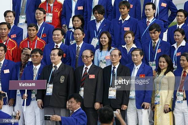 Vietnamese athletes attend their welcoming ceremony in the athletes village at the 15th Asian Games in Doha 30 November 2006 one day before the games...