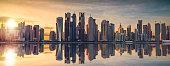 The skyline of Doha, Qatar during sunset