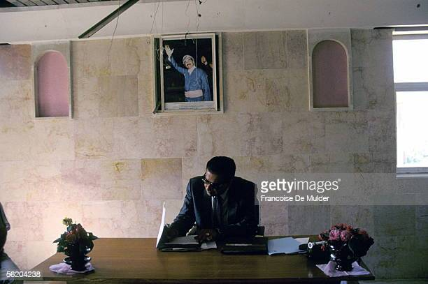 Dohuk The mayor in his office under the portrait of Saddam Hussein 1991