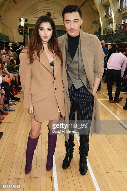 Doina Cioabnu and Hu Bing attend the Vivienne Westwood show during London Fashion Week Men's January 2017 collections at Seymour Leisure Centre on...