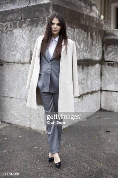Doina Ciobanu blogger wearing an Armani coat vintage Escada suit Ted Lapidus shirt and Christian Louboutin shoes at Paris Fashion Week Autumn/Winter...