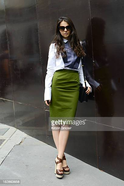 Doina Ciobanu fashion blogger wearing YSL shoes Celine bag shirt and sunglasses and a Givenchy skirt on day 3 of Paris Fashion Week Womenswear...