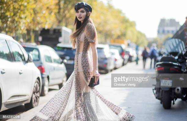 Doina Ciobanu wearing beret sheer dress is seen outside Dior during Paris Fashion Week Spring/Summer 2018 on September 26 2017 in Paris France