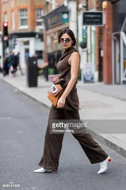 Doina Ciobanu wearing brown stripped pants knit JW Anderson bag outside JW Anderson during London Fashion Week September 2017 on September 16 2017 in...