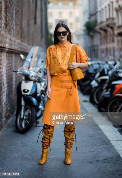 Doina Ciobanu wearing yellow orange blouse and skirt noots is seen outside Max Mara during Milan Fashion Week Spring/Summer 2018 on September 21 2017...