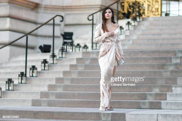 Doina Ciobanu wears a silk dress outside the amfAR dinner at Petit Palais during Paris Fashion Week Haute Couture Fall/Winter 20172018 on July 2 2017...