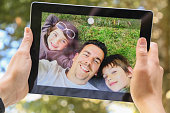Doing a selfie with my family on tablet