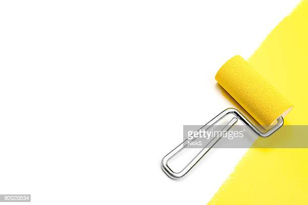 Doing home improvement by painting a white wall yellow