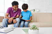Father helping his son to do homework