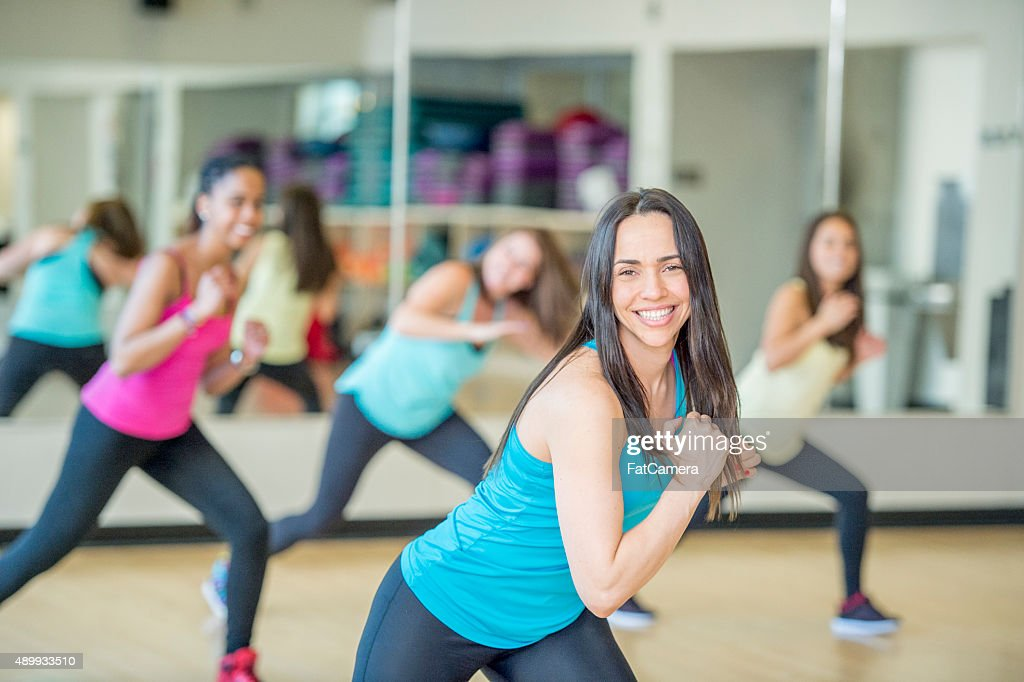 Doing Lunges in a Dance Fitness Class : Stock Photo