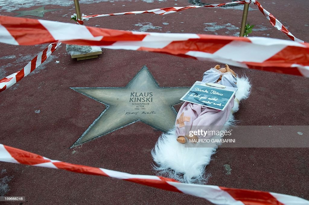 A doll and a sign reading 'Thanks Klaus, it doesn't hurt anymore' was put by Berlin artist Uschi Leonhardt next to the star of German actor Klaus Kinski in Berlin, on January 18, 2013. With the action, Leonhardt aims to call attention to the allegations against Klaus Kinski to have repeatedly raped his daughter. Actress Nastassja Kinski accused her father of attempting to abuse her, following allegations by her half-sister Pola that he raped her throughout her childhood.