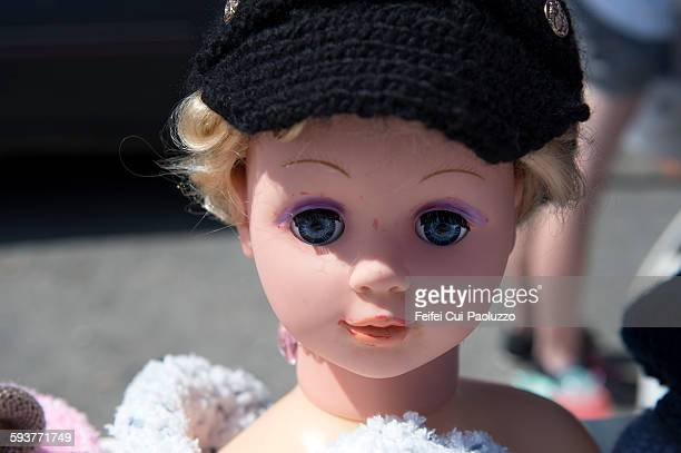 Doll at street market of Barfleur Manche France