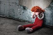 Doll Crying in dirty floor., Dark tone.