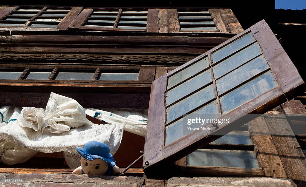 A doll is kept on a window sill by Kashmiris to taunt the Indian police during a curfew-like restriction on March 7, 2013 in Srinagar, the summer capital of Indian Administered Kashmir, India. Clashes erupted in most parts of Kashmir today leaving scores of people injured. Meanwhile Indian authorities imposed curfew-like restrictions for the second consecutive day in most parts of Kashmir following the killing of a Kashmiri youth by the Indian army in North Kashmir's Baramulla district.