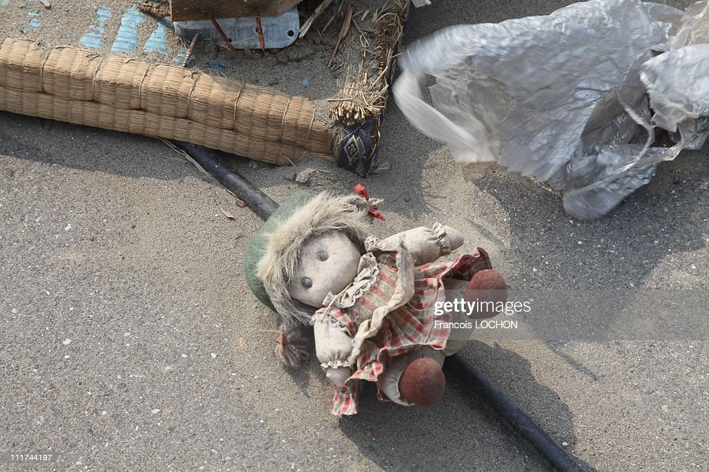 A doll is left in the rubble destroyed by the earthquake on April 4,2011, in Myako City,Japan. These objects are from the 30 000 victims of the earthquake that hit Japan on March 11, 2011 followed by an tsunami.