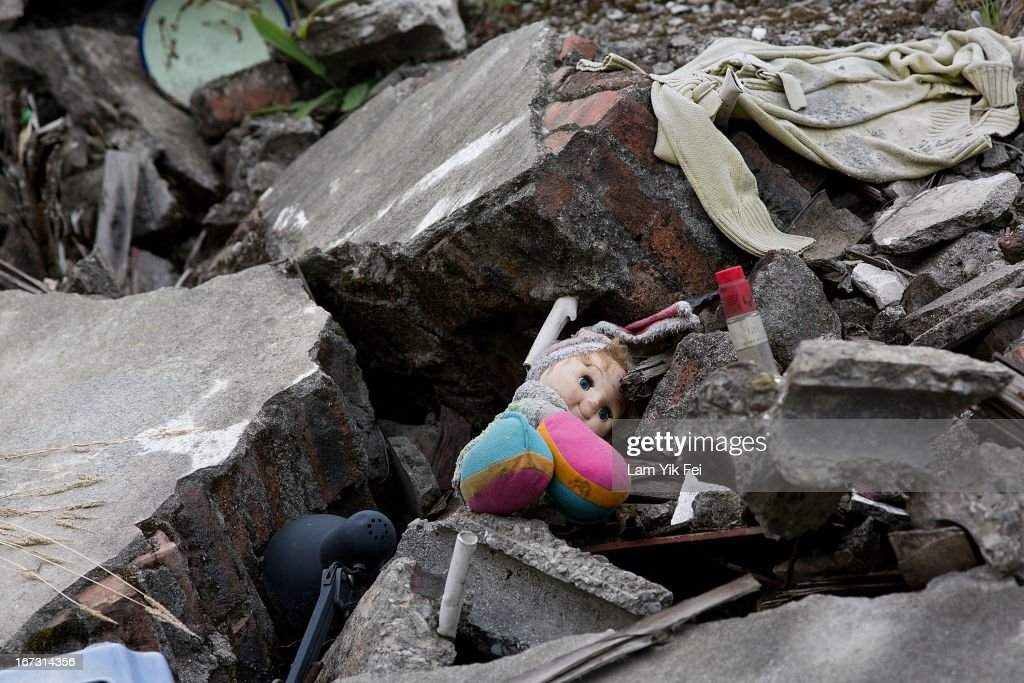 A doll lies between rubbles of a collapsed building at the earthquake memorial park at the new Beichuan town in Sichuan province on April 24, 2013 in Chengdu, China. The Beichuan earthquake memorial was built in memory of the over 70,000 that perished in the deadly 2008 quake that struck Sichuan province and was built near the Beichuan Middle School, where over 1,000 students and teachers died. With the five year quake anniversary only a few weeks away, residents of Sichuan province are coming to grips with the April 20 earthquake in nearby Ya'An that claimed the lives of over 190 people and injured thousands.