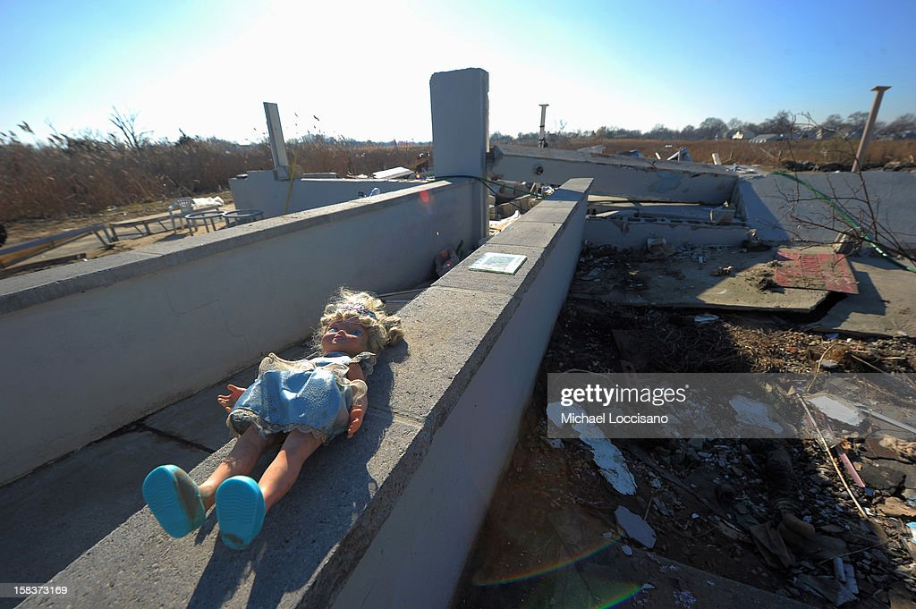 A doll lies on a wall at a onetime residence, now a vacant lot of wreckage on December 14, 2012 in Union Beach, New Jersey. The town is struggling to rebuild and recover from the devastation left by Superstorm Sandy and relying heavily on donations.