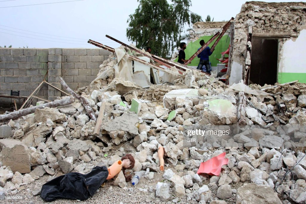 A doll lies on the rubble of a destroyed house as Iranian residents inspect the damage in the town of Shonbeh, southeast of Bushehr, on April 10, 2013, a day after a powerful earthquake struck near the Gulf port city of Bushehr. Rescuers wound up operations after pulling 20 people from the rubble of a 6.1 magnitude earthquake that struck near the port city of Bushehr, killing 37 people but sparing Iran's sole nuclear power plant. AFP PHOTO/STR