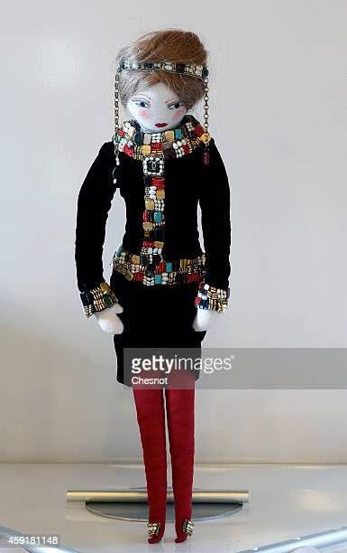 A doll named 'Paris Bysance' created by designer Karl Lagerfeld fashion house Chanel is displayed at the 'Frimousses de Createurs' exhibition launch...