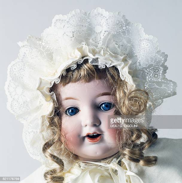 Doll No 992/9 with white bonnet and eyelet fabric trimming made by Armand Marseille Germany 20th century Detail Germany
