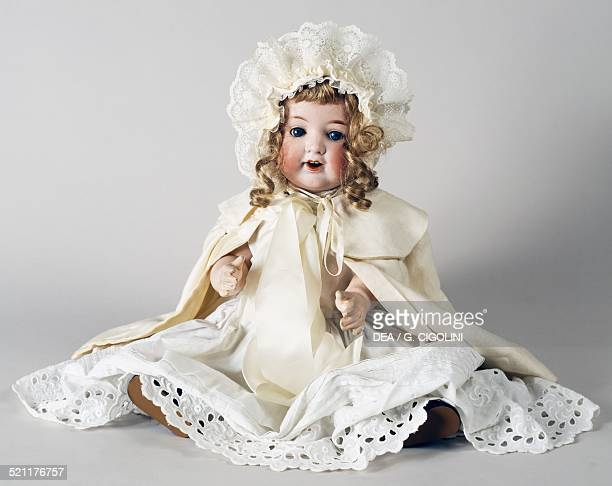 Doll No 992/9 with white dress and eyelet fabric trimming made by Armand Marseille Germany 20th century Germany
