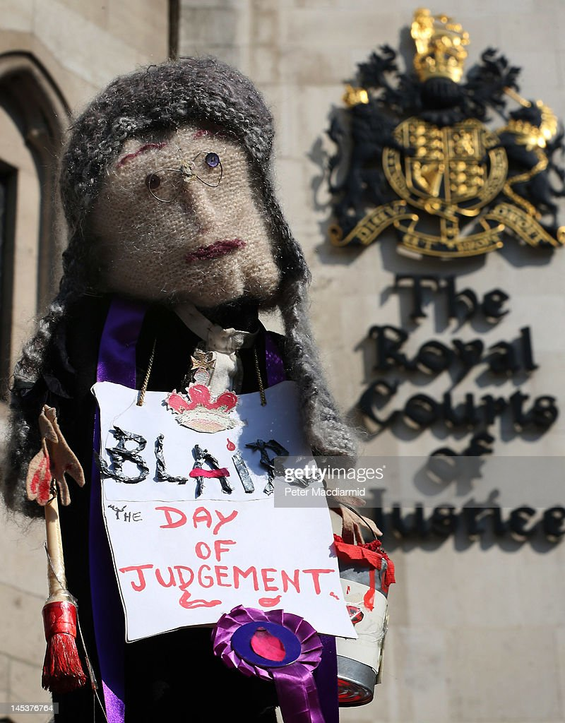A doll of a judge is held aloft by an antiwar protestor outside The Royal Courts of Justice as Former Prime Minister Tony Blair begins to give...