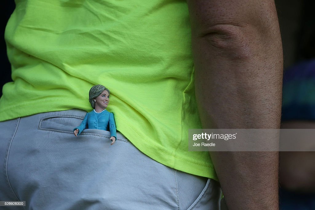 A doll of Democratic presidential candidate Hillary Clinton is seen in the back pocket of a person as he waits for her to make a campaign stop at the Douglass Park Gynasium on May 1, 2016 in Indianapolis, Indiana. Presidential candidates continue to campaign across the state leading up to Indiana's primary day on May 3.