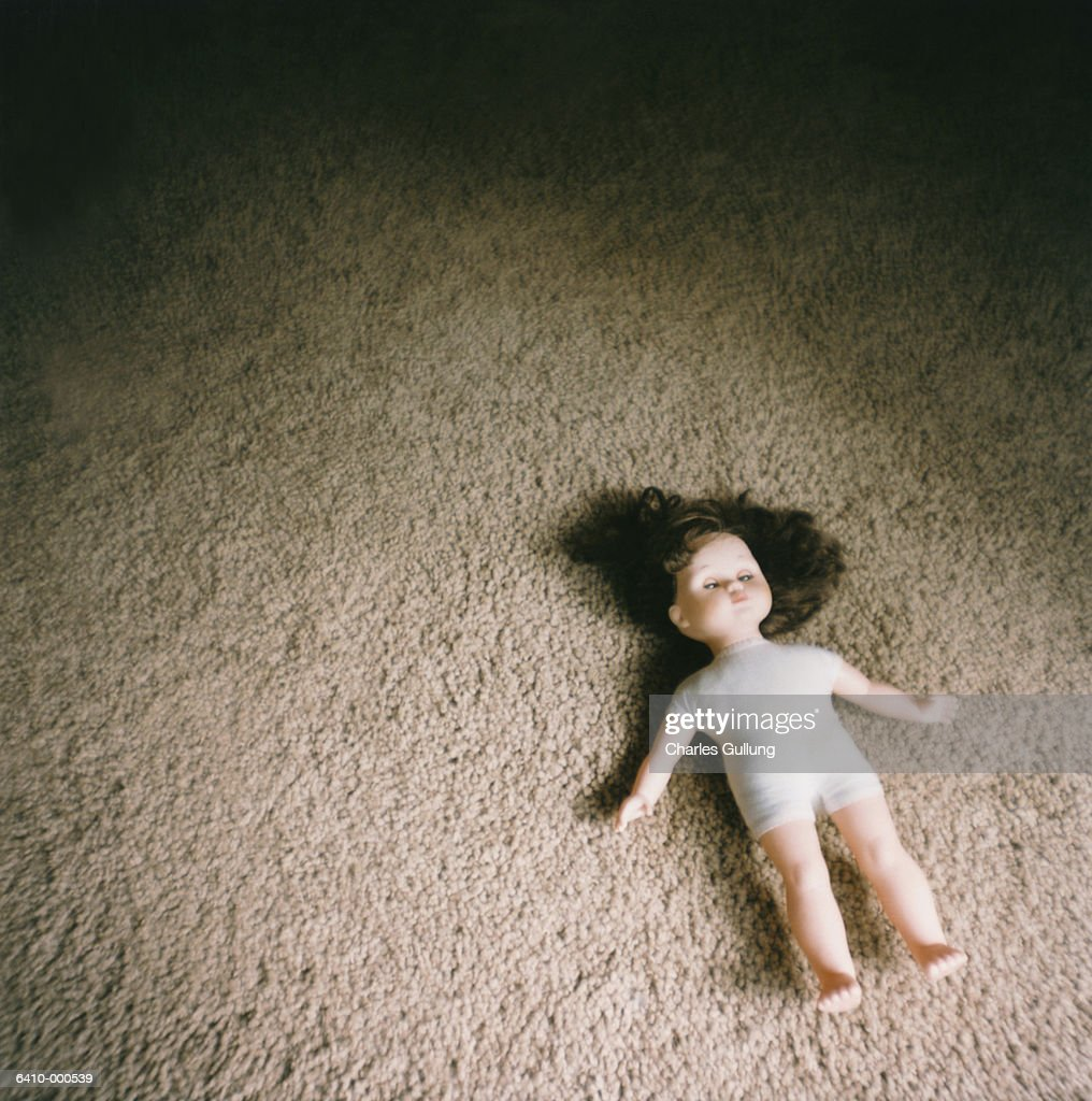 Doll on Carpeted Floor : Stock Photo
