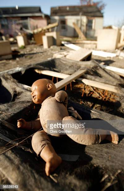 A doll rests inside a mattress on the former foundation of a house moved by Hurricane Katrina January 7 2006 in New Orleans Louisiana The New Orleans...